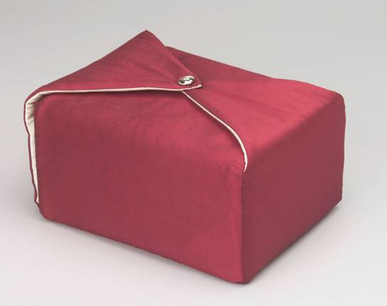 Urn covered in maroon fabric